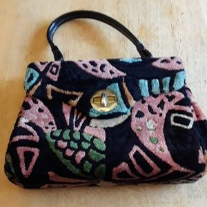 Vintage multi colored purse with leather handle